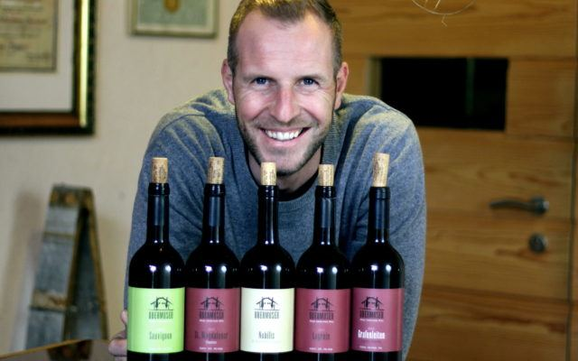 Winegrower Thomas with his native Alpine wines from South Tyrol